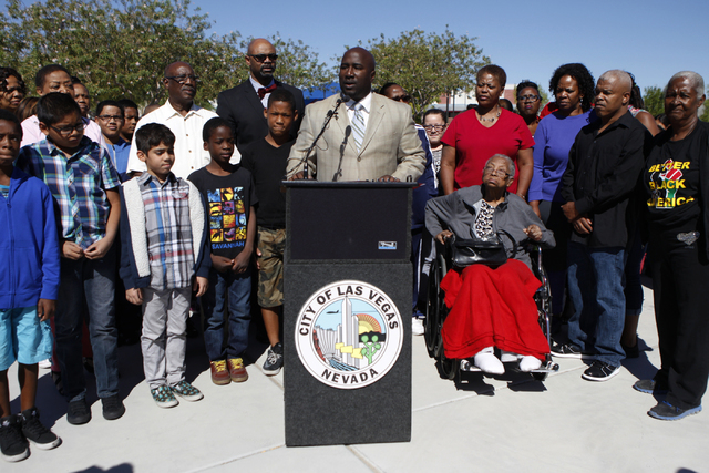 Las Vegas City Councilman Ricki Barlow, center, speaks during a press conference on the newly installed crosswalk traffic lights at the intersection of Martin Luther King Boulevard and Balzar Aven ...