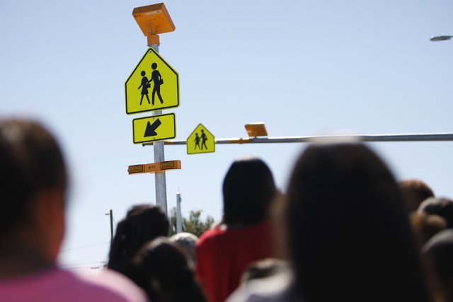 Students from Booker Sr. Elementary School in Las Vegas participate during a press conference for a newly installed crosswalk light at the intersection of Martin Luther King Boulevard and Balzar A ...