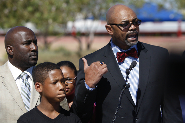 Las Vegas City Councilman Ricki Barlow, from left, Montreal Smith, 11, listen to Marcus Mason, principal at Booker Sr. Elementary School, as he speaks during a press conference on the newly instal ...