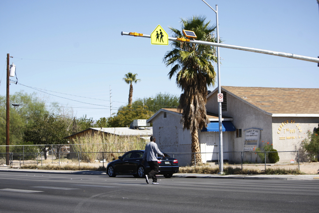 A newly installed crosswalk traffic light is seen at the intersection of Martin Luther King Boulevard and Balzar Avenue in Las Vegas across from Booker Sr. Elementary School Thursday, Oct. 2, 2014 ...