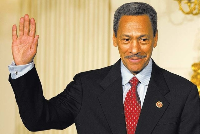 President Barack Obama's nominee for the Federal Housing Finance Authority director Rep. Mel Watt, D-N.C., waves during the announcement of his nomination in the State Dining Room of the White Hou ...