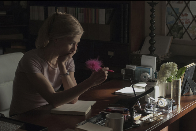 """As her marriage flounders, Amy (Rosamund Pike) expresses her thoughts in a diary in """"Gone Girl.""""  (Twentieth Century Fox and Regency Enterprises)"""