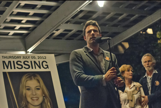 """Nick Dunne (Ben Affleck) finds himself the chief suspect behind the shocking disappearance of his wife, Amy (Rosamund Pike), on their fifth anniversary in """"Gone Girl."""" (Twentieth Century Fox and R ..."""
