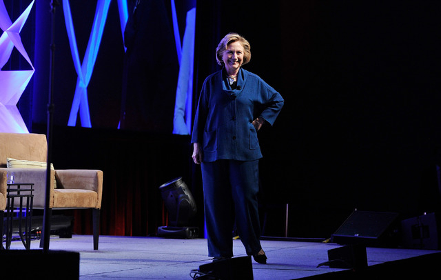 Former Secretary of State Hillary Clinton smiles  after a woman threw an object on to the stage during her remarks at the Institute of Scrap Recycling Industries' annual conference at the Mandalay ...