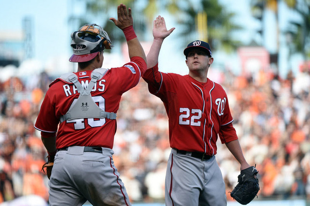 Washington Nationals relief pitcher Drew Storen (22) celebrates with catcher Wilson Ramos (40) after beating the San Francisco Giants 4-1 in game three of the 2014 NLDS baseball playoff game at AT ...