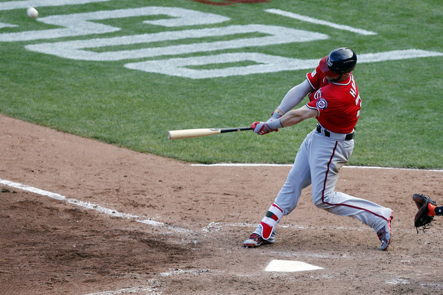 Washington Nationals left fielder Bryce Harper (34) hits a home run during the ninth inning against the San Francisco Giants in game three of the 2014 NLDS baseball playoff game at AT&T Park. (Kel ...