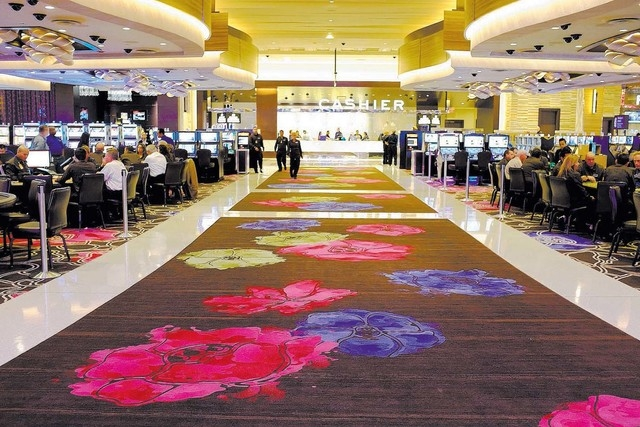 In this Tuesday, Oct. 29, 2013 photo, patterns inspired by Sonoma County flowers are shown on a custom-woven carpet inside the Graton Resort and Casino in Rohnert Park, Calif.  The Las Vegas-style ...