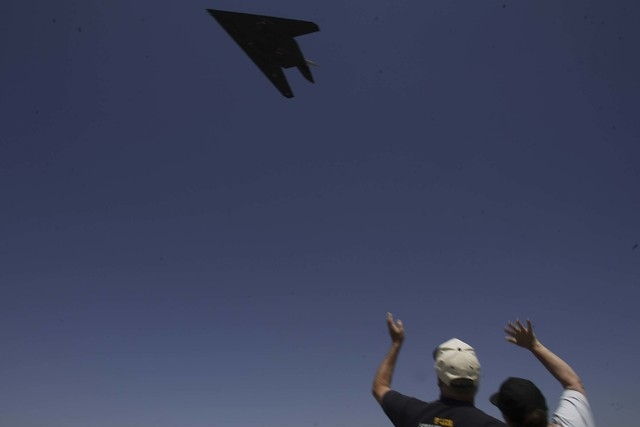 "Phil and Bonnie Harris, from Landcaster, Cal, wave as a F-117A Nighthhawk stealth fighter takes off from the Lockheed Martin ""Skunk Works"" plant in Palmdale, California Tuesday, April 22, 2008, as ..."