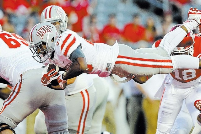 UNLV Rebels running back Keith Whitely (28) dives into the endzone to score a touchdown against the Houston Cougars in the first half of their NCAA Football game at TDECU Stadium in Houston, Texas ...