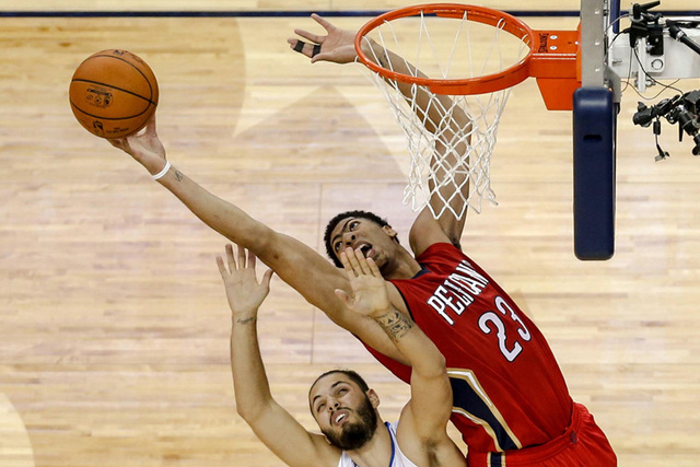 New Orleans Pelicans forward Anthony Davis (23) rebounds over Orlando Magic guard Evan Fournier (10) during the fourth quarter of a game at the Smoothie King Center. The Pelicans defeated the Magi ...