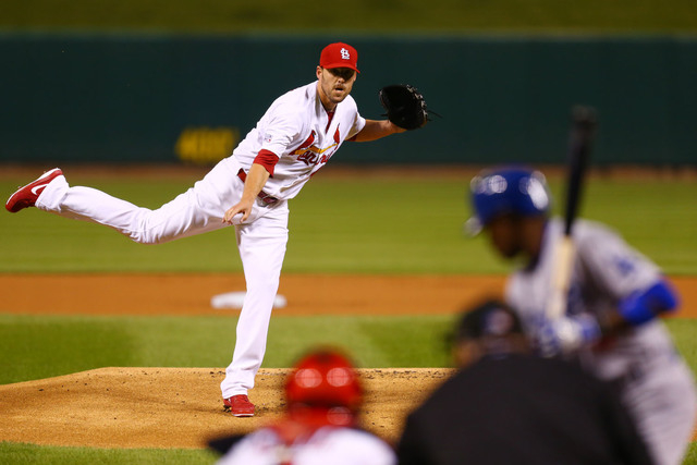 St. Louis Cardinals starting pitcher John Lackey throws a pitch during the first inning of Game 3 of baseball's NL Division Series against the Los Angeles Dodgers, Monday, Oct. 6, 2014, in St. Lou ...