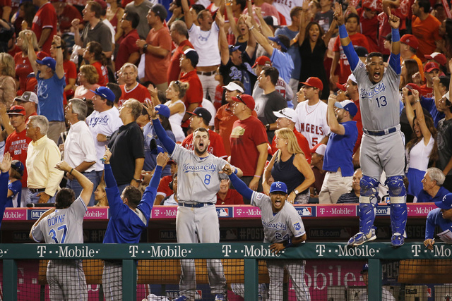 Kansas City Royals players and coaches react after Eric Hosmer hit a two-run home run against the Los Angeles Angels in the 11th inning of Game 2 of baseball's AL Division Series in Anaheim, Calif ...