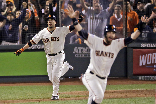 San Francisco Giants Travis Ishikawa reacts after hitting a walk-off three-run home run during the ninth inning of Game 5 of the National League baseball championship series against the St. Louis  ...