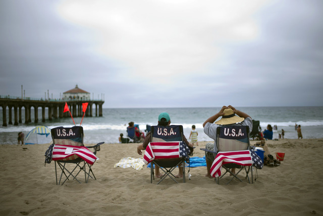 Sergio Desantiago Right And Wife Bertha Sit On Their Beach Chairs In