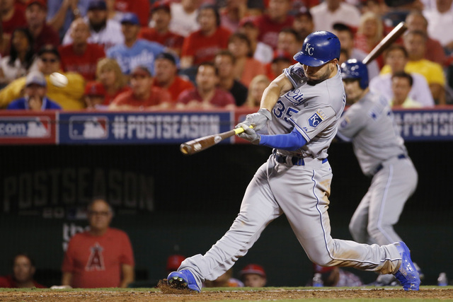 Kansas City Royals' Eric Hosmer hits a two-run home run against the Los Angeles Angels in the 11th inning of Game 2 of baseball's AL Division Series in Anaheim, Calif., Friday, Oct. 3, 2014. (AP P ...