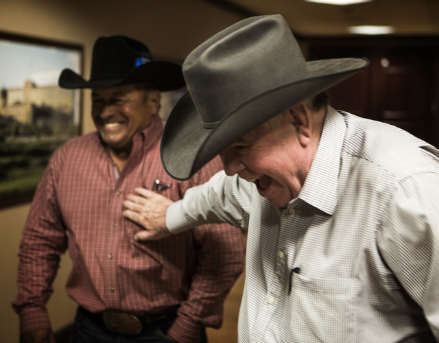 South Point hotel-casino owner Michael Gaughan, right, shares a laugh with Julio Moreno, owner of the bucking bull Bushwacker, at the South Point executive office, 9777 S. Las Vegas Boulevard on M ...