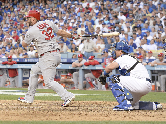St. Louis Cardinals first baseman Matt Adams (32) hits an RBI single in the seventh inning against the Los Angeles Dodgers in game one of the 2014 NLDS playoff baseball game at Dodger Stadium. (Ri ...