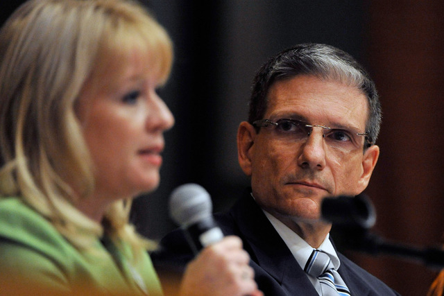 Challenger Erin Bilbray, left, speaks as U.S. Rep. Joe Heck, R-Nev., listens during their debate at Congregation Ner Tamid in Henderson on Monday, Oct. 20, 2014. This is the second of three debate ...