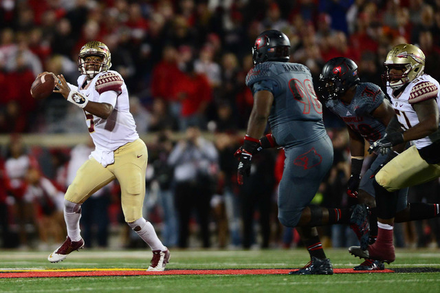 Florida State Seminoles quarterback Jameis Winston (5) scrambles out of the pocket to pass during the second quarter against the Louisville Cardinals at Papa John's Cardinal Stadium. (Andrew Weber ...