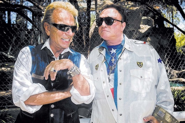 Siegfried Fischbacher and Roy Horn during the unveiling three 14-week-old lion cubs at the Secret Garden at The Mirage on Thursday, July 17, 2014. The cubs, named Freedom, Madiba (in honor of Nels ...