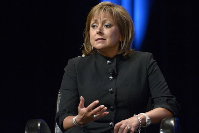 FILE - In this Aug. 22, 2013, file photo, Republican New Mexico Gov. Susana Martinez answers a question during a panel discussion at the Wal-Mart U.S. Manufacturing Summit in Orlando, Fla. Martine ...