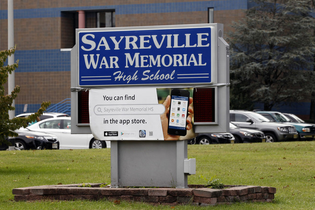 This photo shows a sign at Sayreville War Memorial High School in Sayreville, N.J.  Seven students were charged Friday night after an investigation into hazing on the Sayreville War Memorial High  ...
