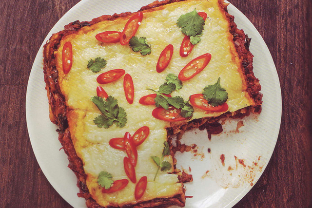Layered cornmeal with spicy tomato sauce. (Courtesy)