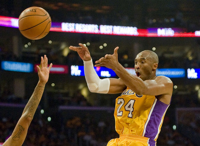 Lakers guard Kobe Bryant passes the ball away at the top of the key in the second period of Tuesday's game against Houston Oct. 28, 2014. (AP Photo/The Orange County Register, Paul Rodriguez)