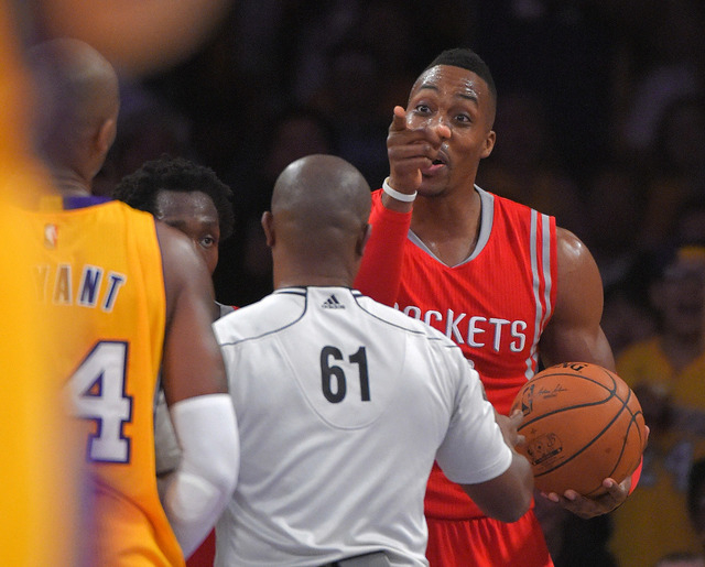 Houston Rockets center Dwight Howard, right, has words with Los Angeles Lakers guard Kobe Bryant during the second half of an NBA basketball game, Tuesday, Oct. 28, 2014, in Los Angeles.  The Rock ...