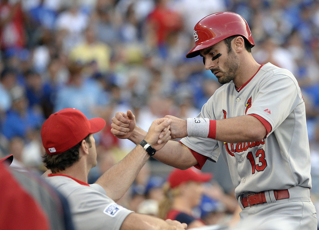 St. Louis Cardinals third baseman Matt Carpenter (13) is congratulated after he hits a solo home run in the sixth inning against the Los Angeles Dodgers in game one of the 2014 NLDS playoff baseba ...