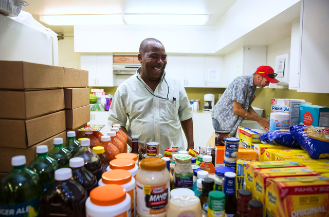 Neville Monteith (cq) waits to hand out food items at the Westminster Presbyterian Church food bank, located at 4601 W. Lake Mead Blvd., on Friday, Sept. 26, 2014. The church is celebrating its 50 ...