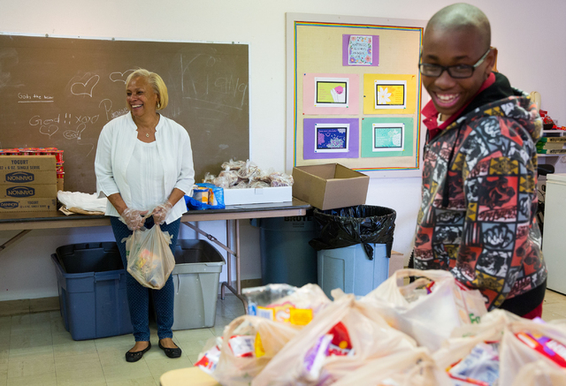 Lillie (cq) Bright, left, and Alex Sanders wait to hand out food items at the Westminster Presbyterian Church food bank, located at 4601 W. Lake Mead Blvd., on Friday, Sept. 26, 2014. The church i ...