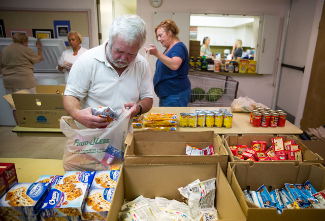 Casey Krumal (cq) organizes food items at the Westminster Presbyterian Church food bank, located at 4601 W. Lake Mead Blvd., on Friday, Sept. 26, 2014. The church is celebrating its 50th anniversa ...