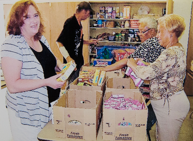 LuAnne Yuyakovich (cq), left, poses while organizing food at Westminster Presbyterian Church food bank, located at 4601 W. Lake Mead Blvd. in the undated, submitted photo.