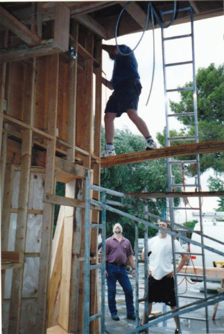 Men of Westminster Presbyterian Church build the Narthex in 1999 under the direction of Ted Brown, head of building and grounds (in purple shirt). Layton O'Neill is in the white shirt. (Courtesy P ...