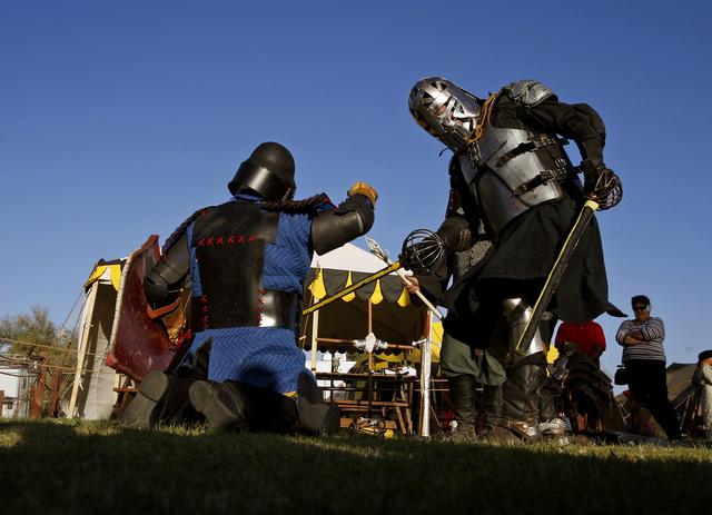 Armored knights Gary Gibson, left, a.k.a. Gabriel McQuistin, and Bill Tackett a.k.a. Sir William Pollock, perform a sword battle during the Renaissance Fair at Sunset Park in Las Vegas, Friday, Oc ...