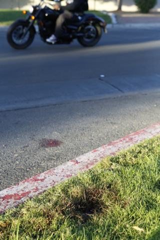 Several blood stains are seen at the scene where a woman was shot after an argument at a North Las Vegas apartment complex early Thursday morning, Oct. 30, 2014. The 42-year-old woman died at Univ ...