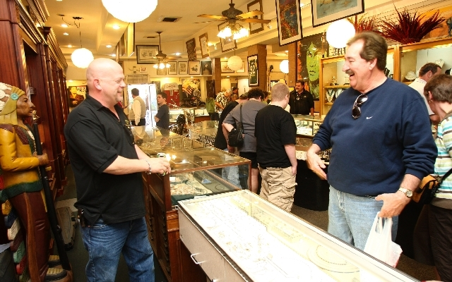 Rick Harrison, owner of the Gold & Silver Pawn Shop, talks with Bill Fiscus of Terre Haute, Ind ...