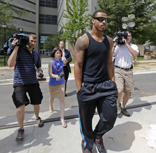Carolina Panthers NFl football defensive end Greg Hardy leaves the Mecklenburg County jail after being released on bond in Charlotte, N.C., Wednesday, May 14, 2014. Hardy was arrested Tuesday and  ...