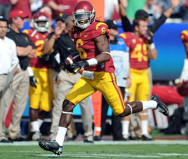 In this Oct. 26, 2013, file photo, Southern California safety Josh Shaw recovers a Utah fumble in an NCAA college football game in Los Angeles. Shaw confessed that he lied to school officials abou ...