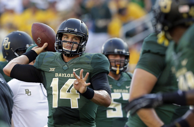 Baylor quarterback Bryce Petty (14) warms up before an NCAA college football game against SMU. (AP Photo/LM Otero)