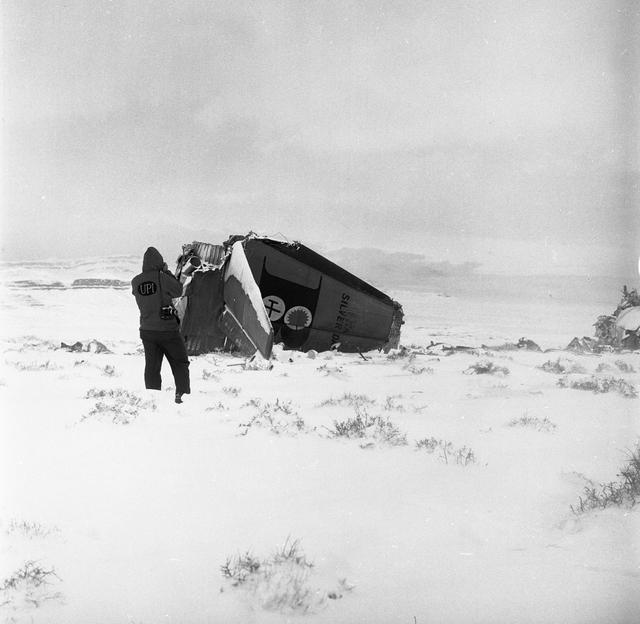 A photographer documents the Bonanza Airlines Flight 114 plane crash on Nov. 16, 1964 (Courtesy Las Vegas News Bureau, Cook)