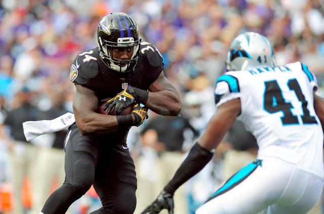 Sep 28, 2014; Baltimore, MD, USA; Baltimore Ravens running back Lorenzo Taliaferro (34) carries the ball in front of Carolina Panthers safety Roman Harper (41) at M&T Bank Stadium. (Evan Habeeb-US ...