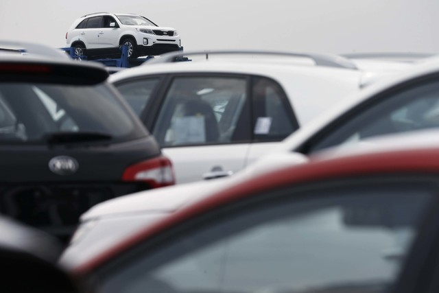 Cars made by South Korea's Hyundai Motor and Kia Motors are parked at their shipping yard at a port in Pyeongtaek, about 43 miles south of Seoul, in this July 25, 2013 file picture. Hyundai Motor  ...