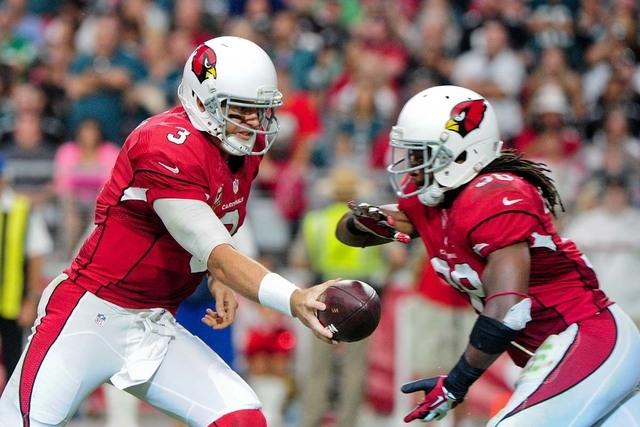 Arizona Cardinals quarterback Carson Palmer (3) hands off to running back Andre Ellington (38) during the second half against the Philadelphia Eagles at University of Phoenix Stadium. (Matt Kartoz ...
