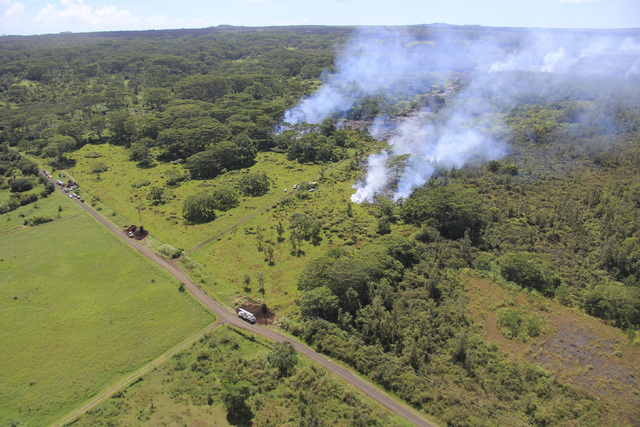 The lava flow from the Kalauea Volcano is seen split into two separate lobes in this aerial picture taken near the village of Pahoa, Hawaii, Friday, Oct. 24, 2014. (Reuters/U.S. Geological Survey  ...