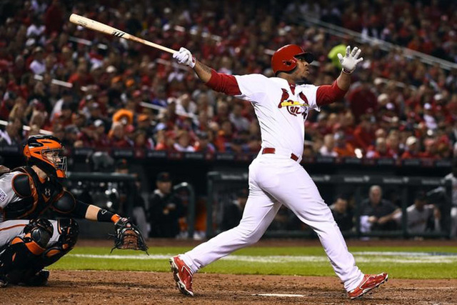 Oct 12, 2014; St. Louis, MO, USA; St. Louis Cardinals pinch hitter Oscar Taveras (18) hits a solo home run against the San Francisco Giants during the 7th inning in game two of the 2014 NLCS playo ...