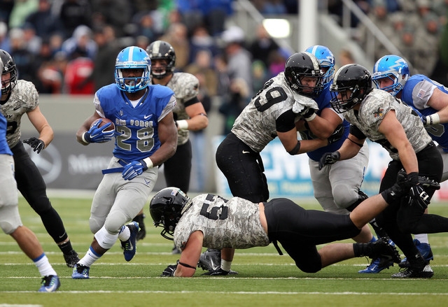 Air Force running back Jacobi Owens (28) rushes against the Army on Nov. 1, 2014, at Michie Stadium at West Point, N.Y. Owens, who went to Centennial High School, leads the Falcons with 853 yards  ...