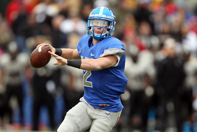 Air Force quarterback Kale Pearson guides the Falcons triple option. Pearson, shown against Army on Nov. 1, 2014, has passed for 1,098 yards and rushed for 411. (Danny Wild-USA TODAY Sports)