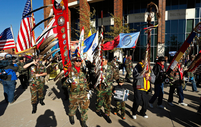 Nov 2, 2014; Minneapolis, MN, USA; Protestors who oppose the name and imagery used by the Washington Redskins organization march outside TCF Bank Stadium before the game between the Redskins and t ...